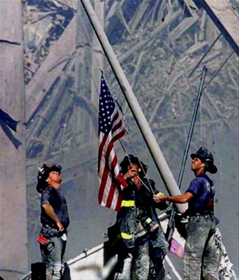 A sign of hope: Firemen raise flag at Ground Zero